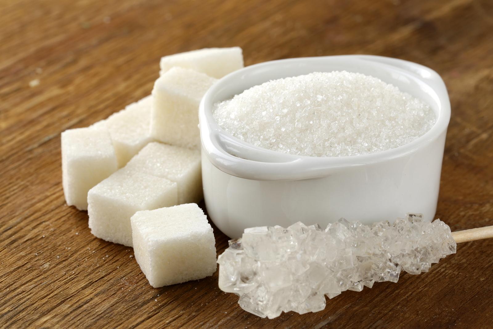 Several types of white sugar - refined sugar and granulated suga