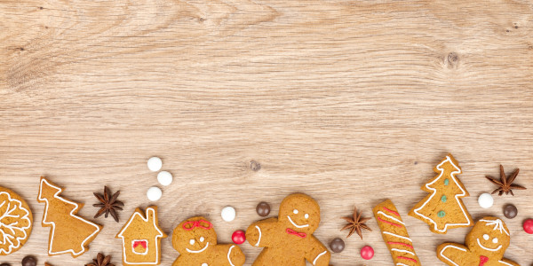Homemade various christmas gingerbread cookies on wooden backgro